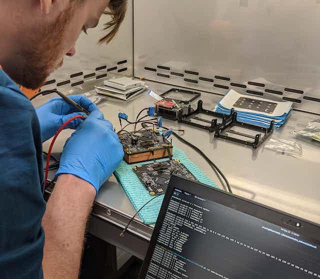 Fergus Downey working on Binar-1 circuit board