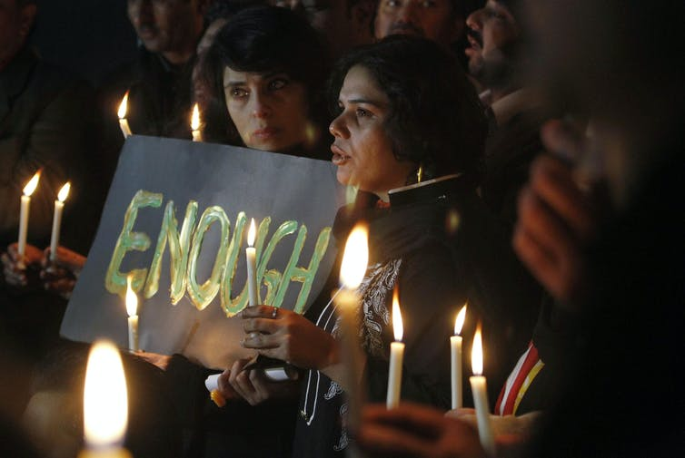 Candlelight vigil for the victims of a school attack.
