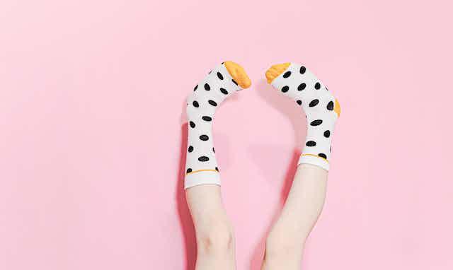 feet in polka dot socks pointing upwards