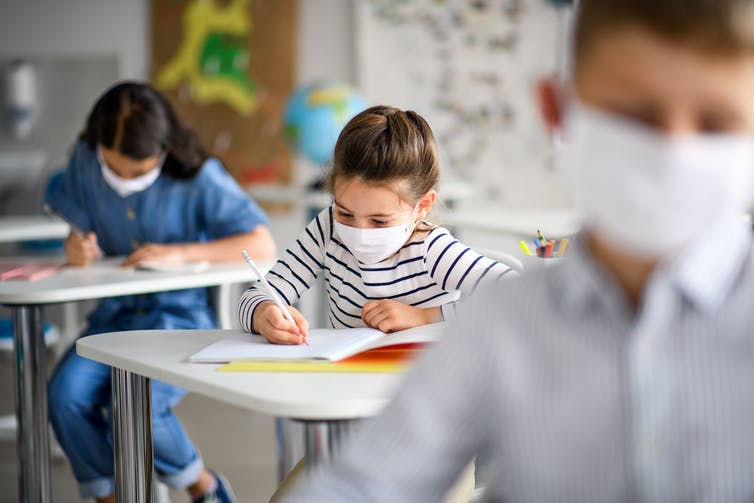 Students in class wearing masks.
