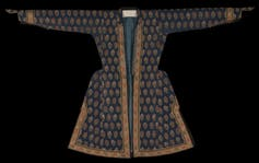Silk robe with gold hem and a rose tree print