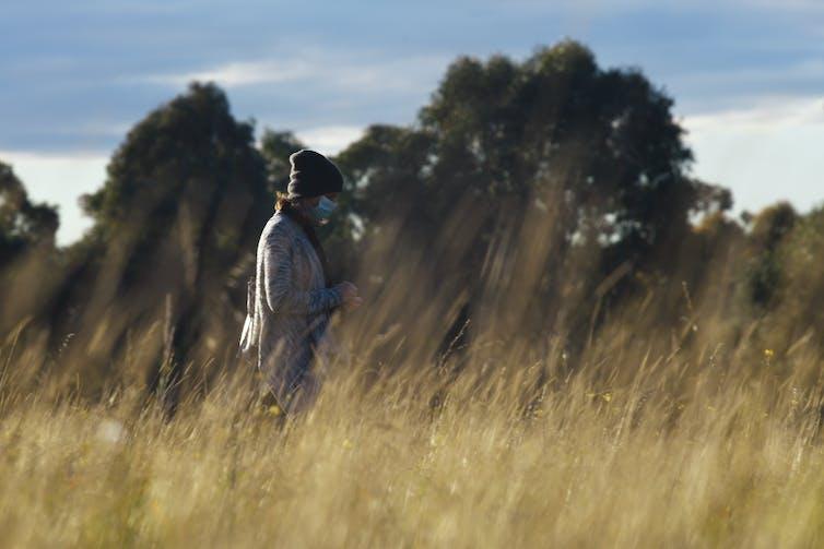 Woman walking in a field.