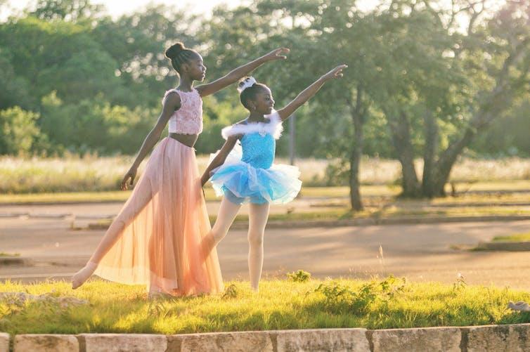 Two young Black girls dancing