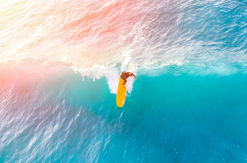 A surfer on a wave.