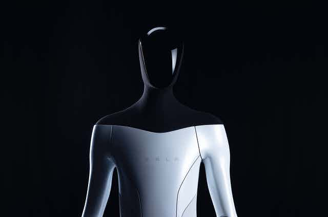 Head and torso of a humanoid robot with the name Tesla on its chest