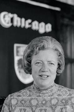 Portrait of Hanna Gray in front of a University of Chicago crest