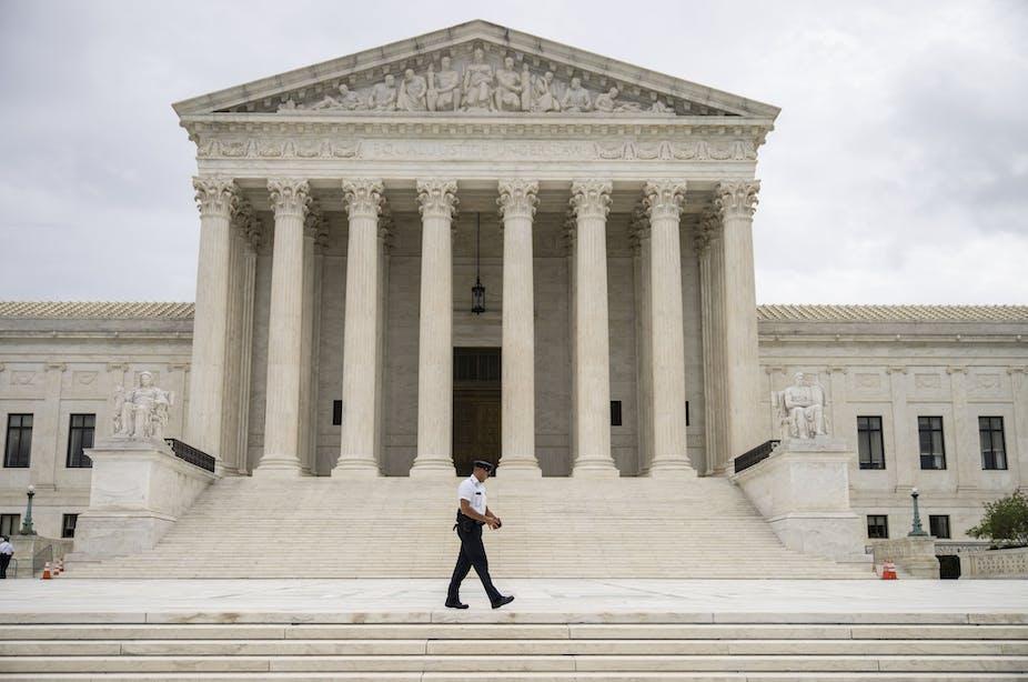 A Supreme Court Police officer patrols at the U.S. Supreme Court on September 1, 2021 in Washington, D.C.