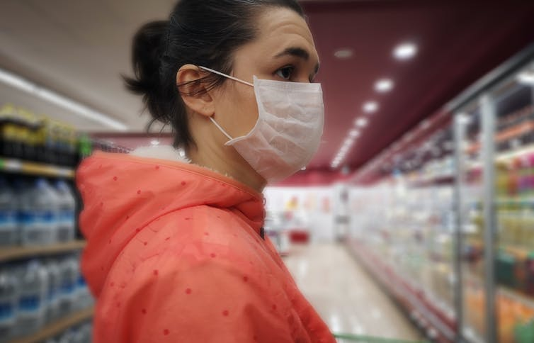 woman in grocery store wearing mask