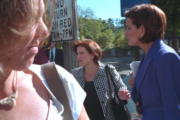 Two women outside the White House.