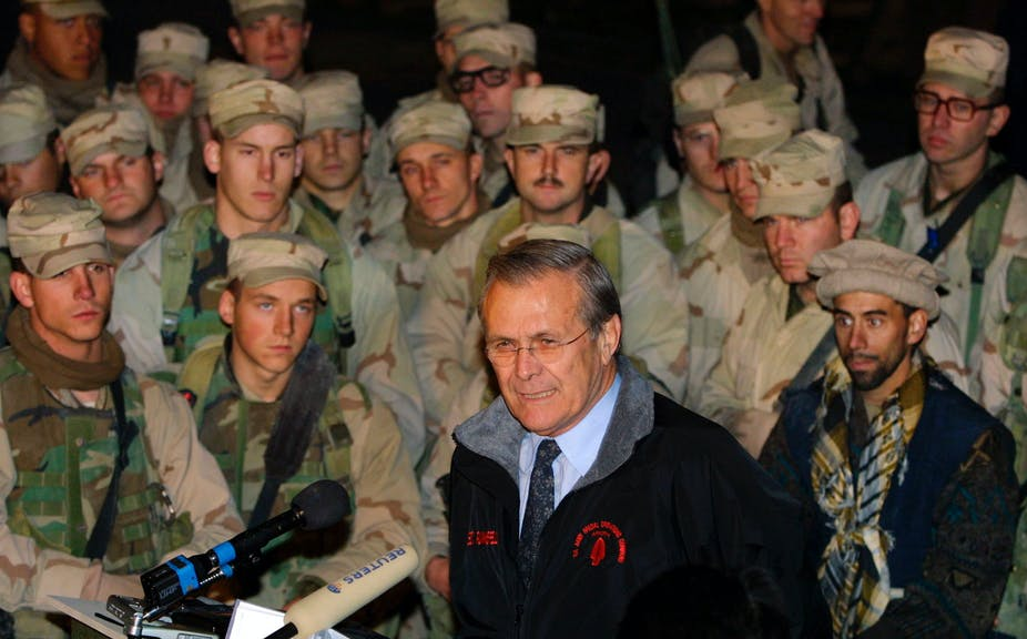 U.S. Secretary of Defense Donald Rumsfeld (C) addresses members of the 10th Mountain Division December 16, 2003 at Baghram Air Base in Afghanistan.