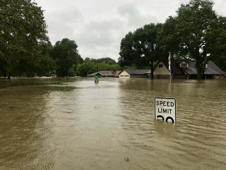 A house is submerged in floodwaters.