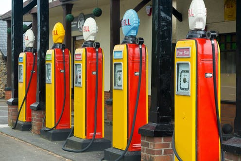 Five yellow and red retro petrol pumps.