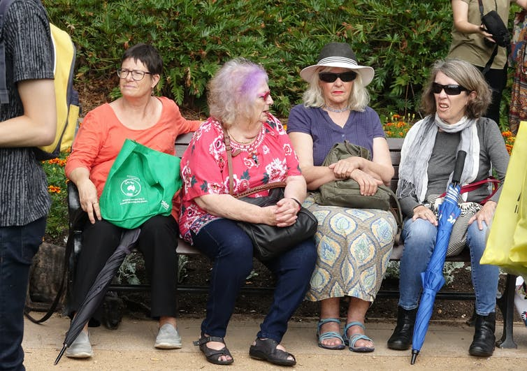 Women sitting on a bench.