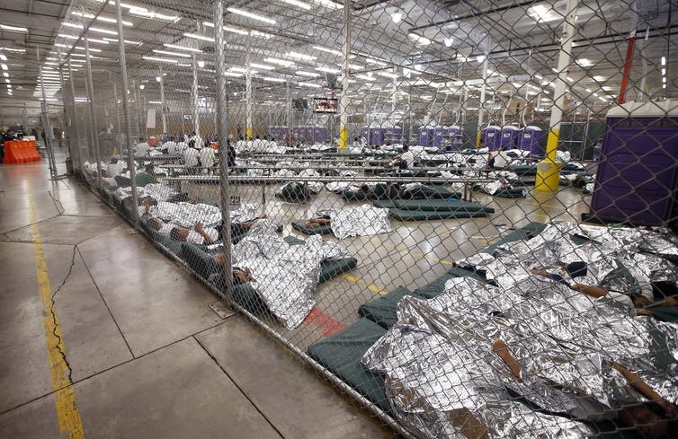 Detainees in a holding cell at the US-Mexico border.