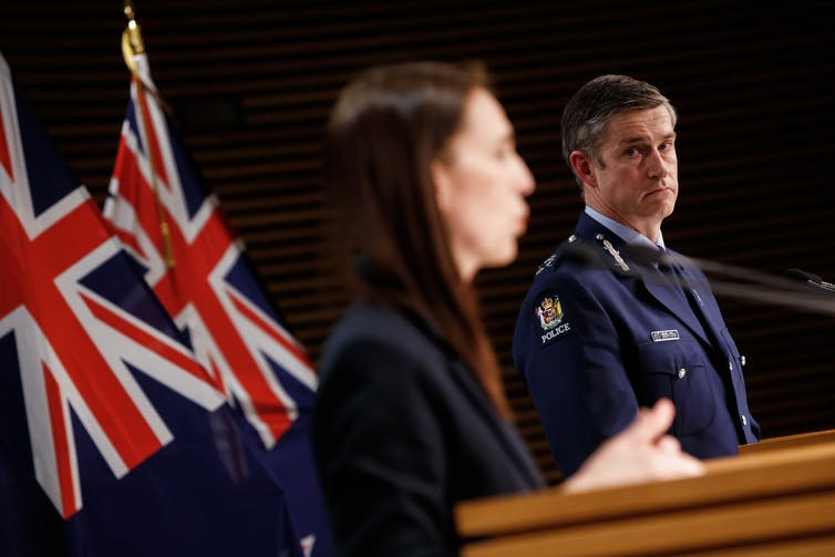 Police Commissioner Andrew Coster and Prime Minister Jacinda Ardern at lecterns