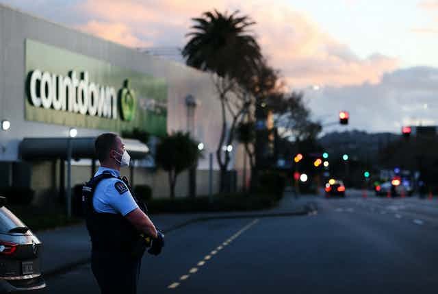 armed police officer outside supermarket