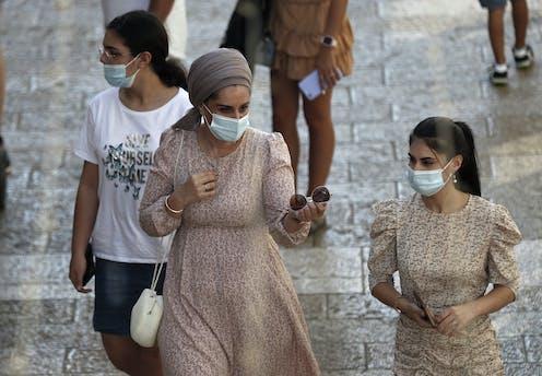 Israeli women in masks walking outside