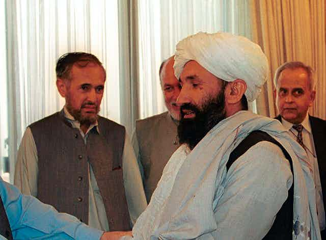 Mullah Hasan Akhund as part of a delegation of Afghan ministers meeting then Pakistani prime minister Nawaz Sharif in 1999.