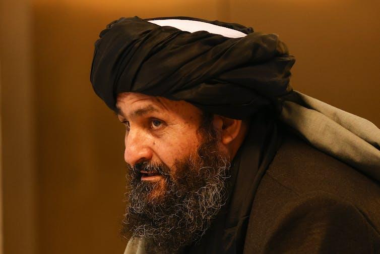 Abdul Ghani Baradar attending peace talks in March 2021.