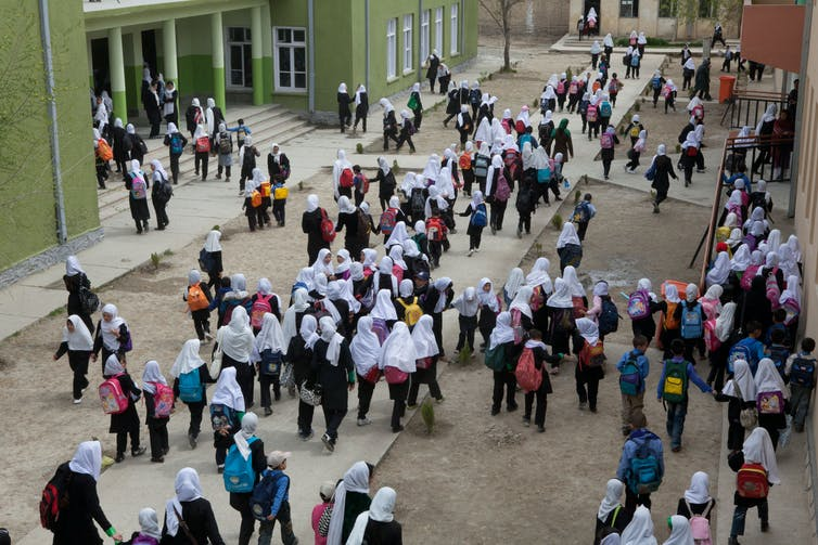 Schoolchildren head into class in a girls' school in Kabul