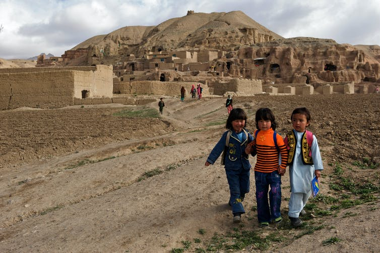 Children make their way to school from their village in the hills of Bamyan province