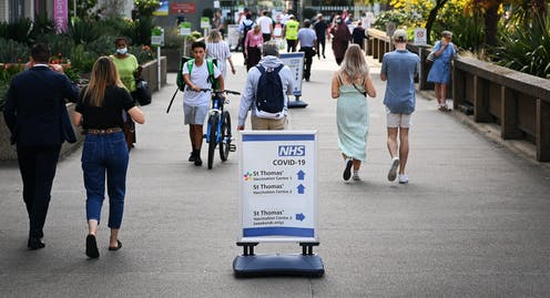 People walking outside of a London hospital