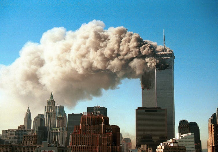 Smoke pours from the Twin Towers of the World Trade Center in New York City on September 11, 2001.