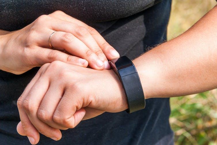 woman checks smart watch