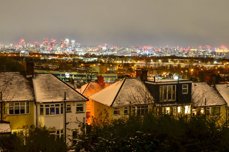A London skyline with suburbs in the foreground and city in the background.