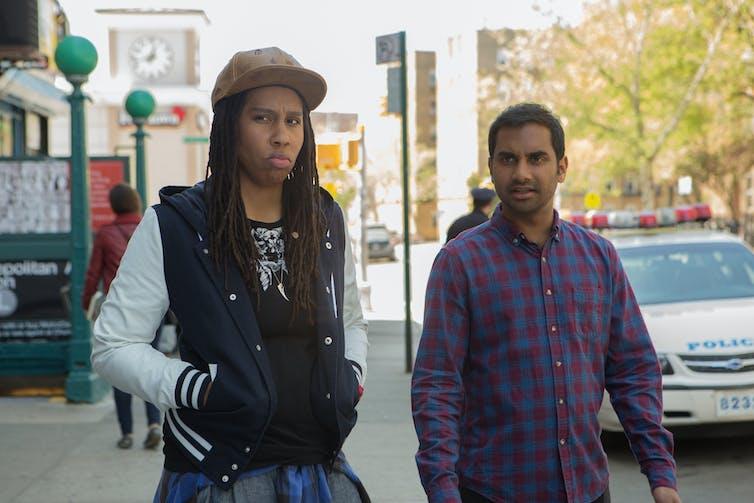 Waite, left, and Aziz Ansari, right.