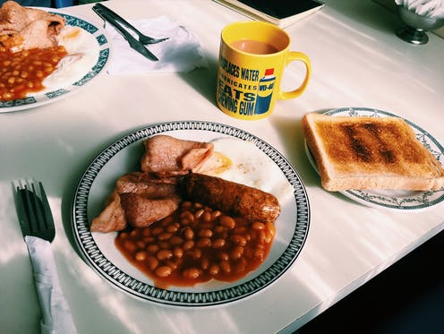 A full English breakfast on a white table
