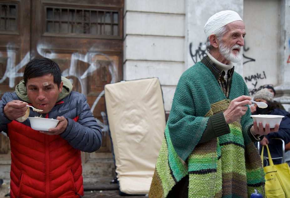 Chilean Muslims and people from other religious communities eat a meal at the weekly soup kitchen in Santiago, Chile.