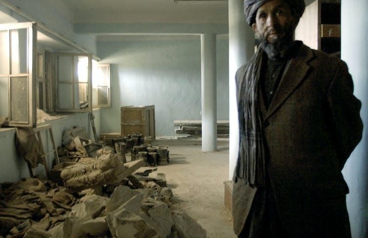 A man next to rubble.
