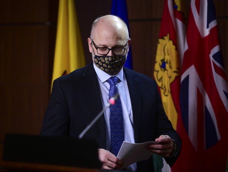 David Lametti wearing a face mask standing at a podium