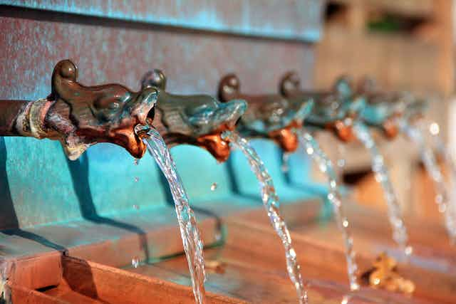 A series of taps with water flowing from them