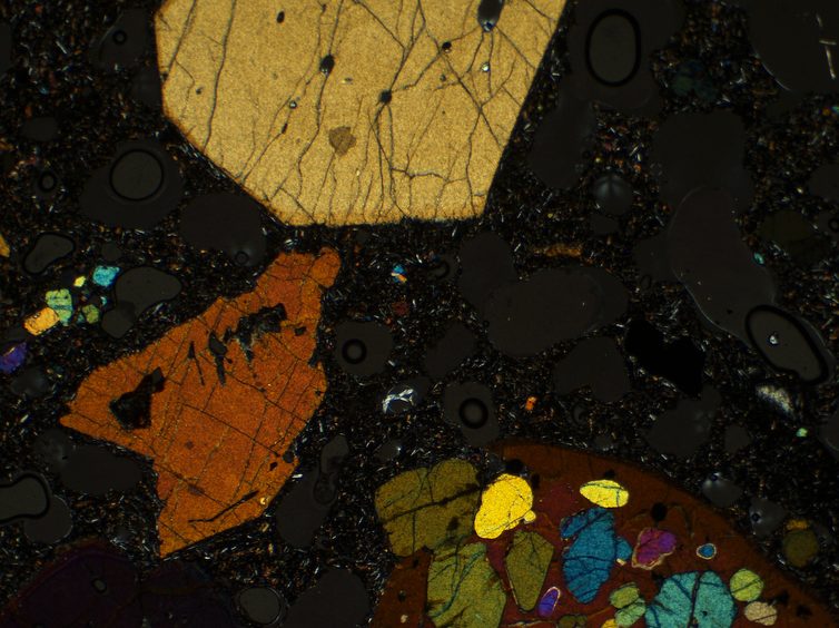Microscopic image of crystals in magma.