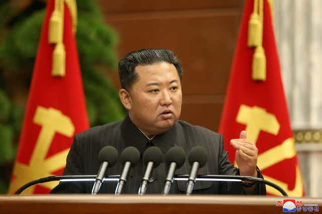 North Korean leader, Kim Jong-un makes a speech at a podium in Pyongyang, September 2021.