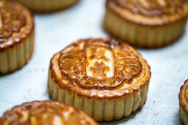 Traditional mooncakes on a pan.