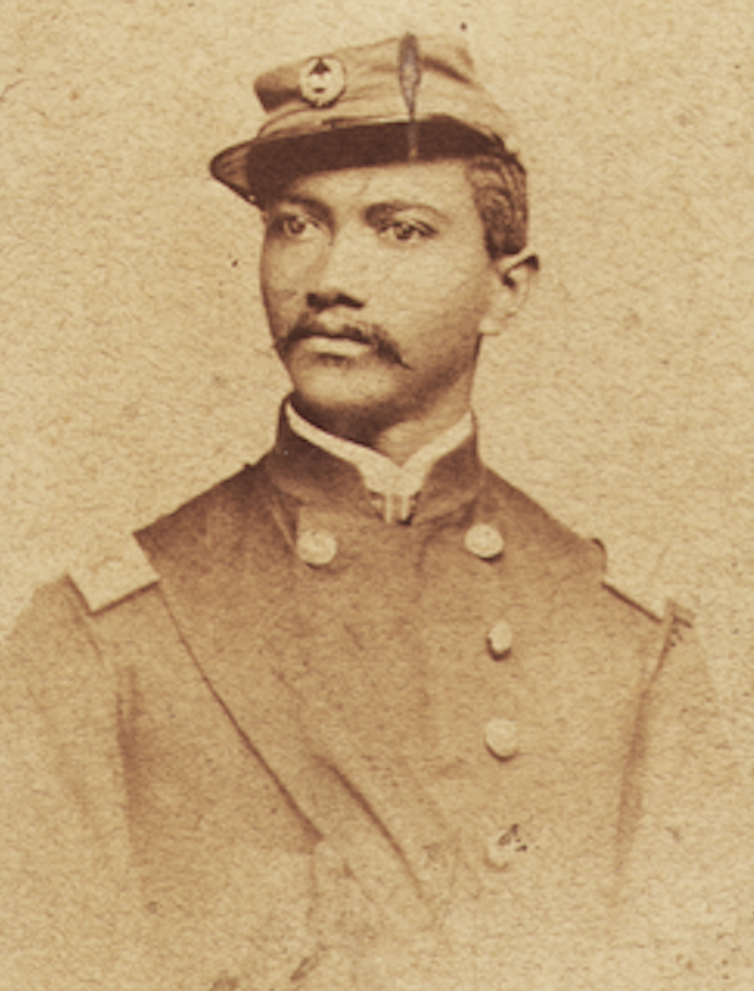 Old portait image of a Black man who served during the American Civil War.