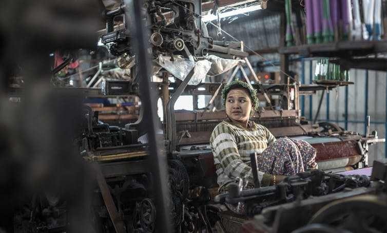 A young woman working in a sewing sweatshop in Myanmar.
