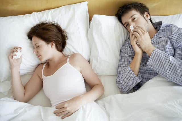 couple sick in bed