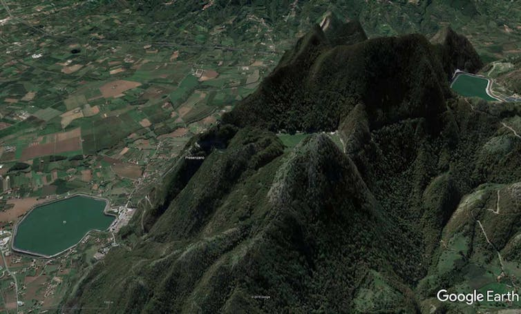 Google Earth synthetic image of a Gigawatt-rated off-river PHES site at Presenzano in Italy, showing the two reservoirs (upper right and lower left)
