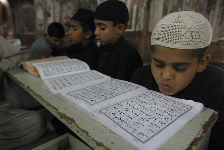 Boys study in a Madrassa in 2016