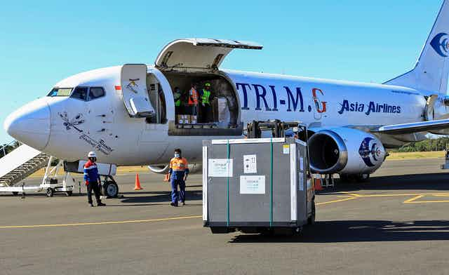 A Covax shipment being unloaded from a plane in East Timor