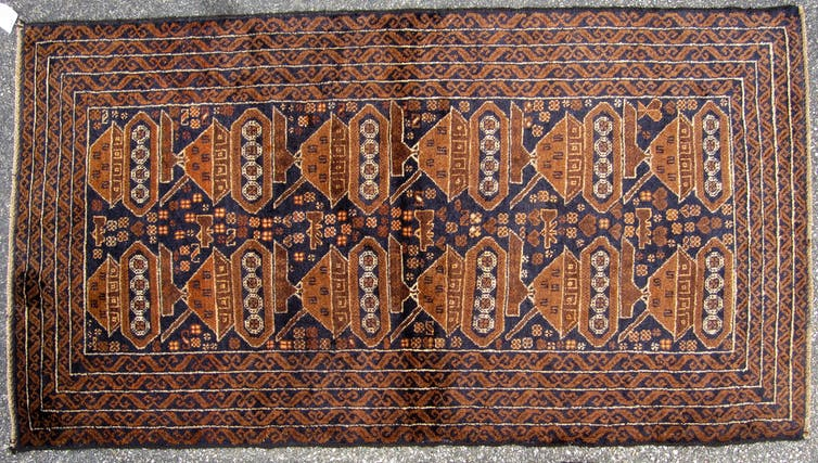 Rug featuring a tank pattern.
