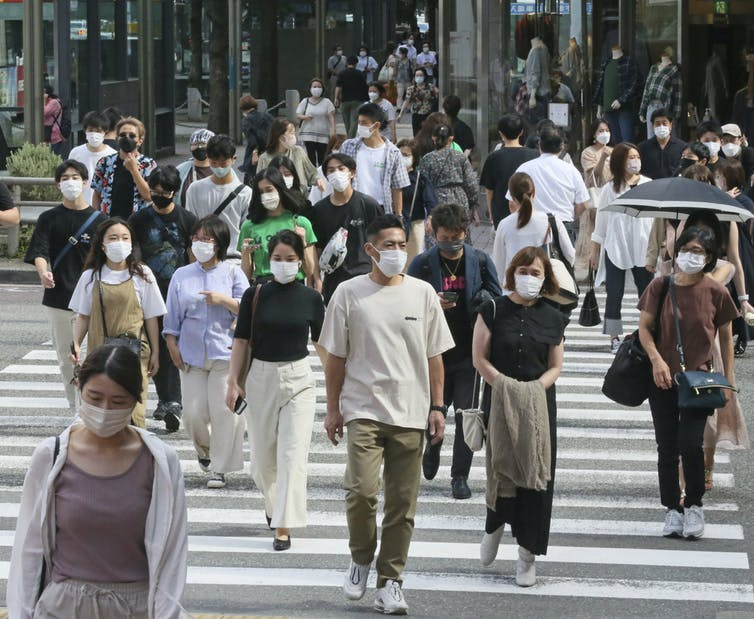 street scene, people in masks