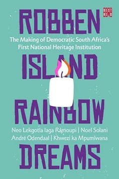 Book cover in green, blue and purple with words 'Robben Island Rainbow Dreams' and an illustration of a candle burning.