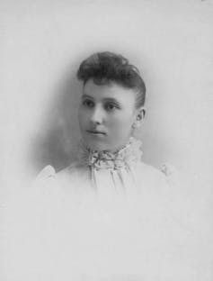 Studio portrait of a young woman in the late 1800s.