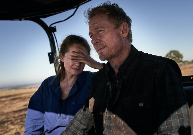 Production image: Miranda Otto and Richard Roxburgh on a tractor