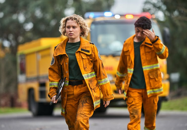 Production still: two firefighters